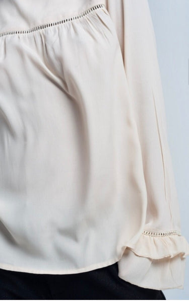 close up of cuffs of cream high neck smock style Frill cuff blouse top - LB Boutique
