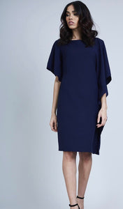 lady wearing navy knee length Ruffle Side Dress - LB Boutique