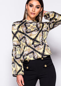 Lady wearing black and yellow frill Hem Top With open backs with ties and long sleeves -LB Boutique