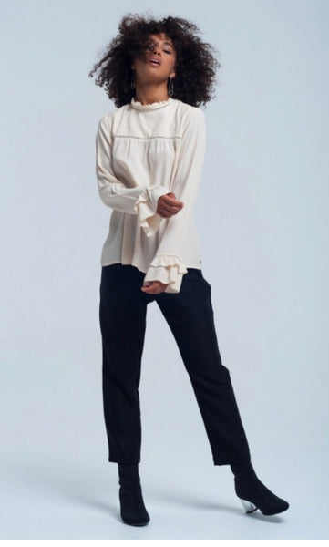 full pictire of lady wearing high neck smock style cream Frill cuff blouse top - LB Boutique