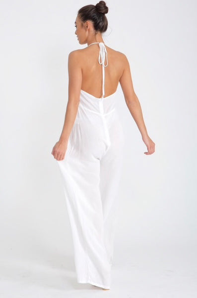 back view of Lady wearing white wide leg hapterneck jumpsuit in cheescloth material - LB Boutique
