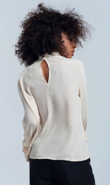 back view of lady wearing smock style cream Frill cuff blouse top - LB Boutique