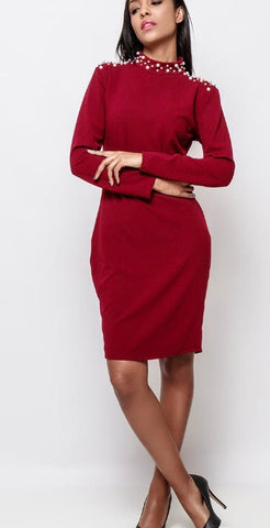 Lady wearing wine pencil dress with high neck and pearl details on shoulder - LB Boutique
