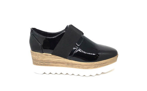 Wood effect and white wedge with black patent brogue style show with elastic band fastening