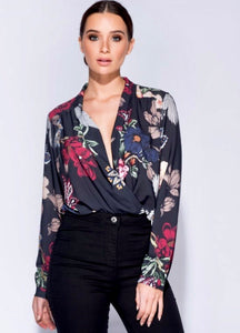 Lady wearing Floral bodysuit with black background - LB Boutique