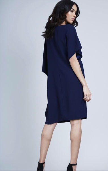 Back view of lady wearing navy knee length Ruffle Side Dress - LB Boutique