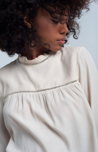 close up of lady wearing high neck smock style cream Frill cuff blouse top - LB Boutique
