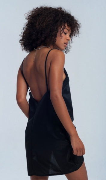 Back view of Lady wearing black Shiny slip dress - LB Boutique
