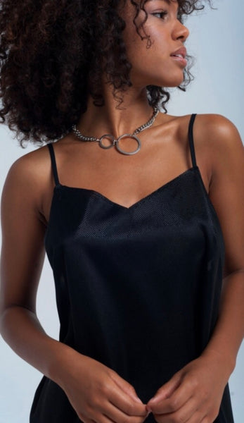 Close up of Lady wearing black Shiny slip dress - LB Boutique