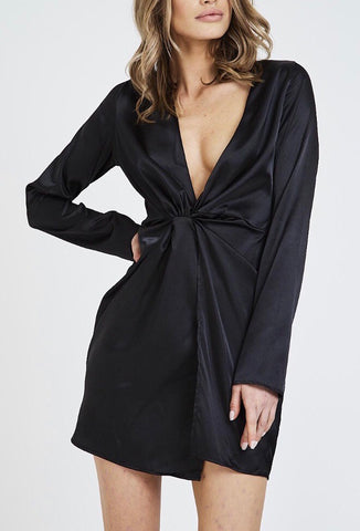 Lady wearing black satin plunge dress with bLong sleeves - LB Boutique