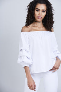 lady wearing white Ruffle sleeve off the shoulder top - LB Boutique