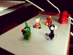 Tiny Sculptures on a piece of notebook paper.