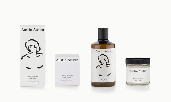 artist designed packaging head illustration Austin Austin certified organic body care duo, made with betaine to soothe, moisturise & protect. Top notes of orange & grapefruit. Middle notes of neroli & cardamom. Base notes of petitgrain & cedar wood.