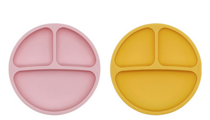 Soft silicone plate with three compartments in dusky pink or mustard yellow for your little one to enjoy eating from. baby kids feeding teething weaning
