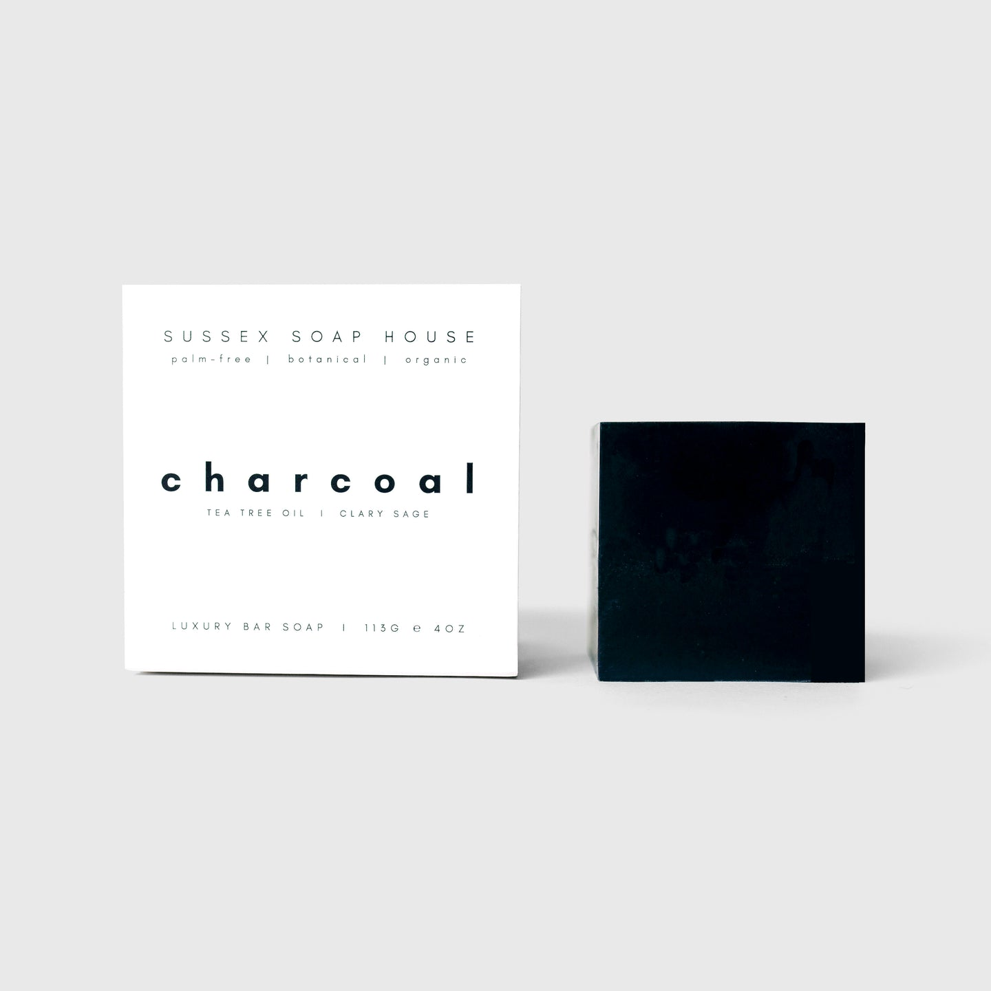 sussex soap house cube clay Formulated with Dorset charcoal, a soothing antibacterial blend of herbal essential oils such as tea tree & rosemary with nourishing cocoa butter, this charcoal bar gently exfoliates, drawing & absorbing impurities from the skin for a deep & natural cleanse