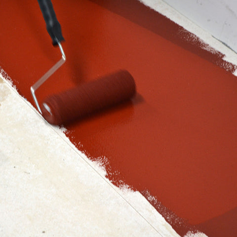 Painting Tile Red Epoxy Floor Paint Anti Slip onto a floor with a roller