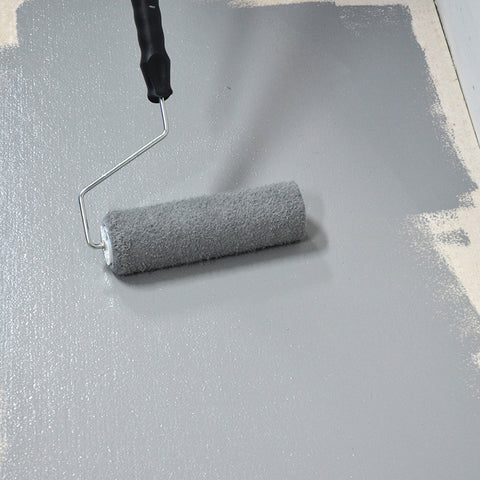 Painting Mid Grey Floor Paint Anti Slip onto a floor with a roller