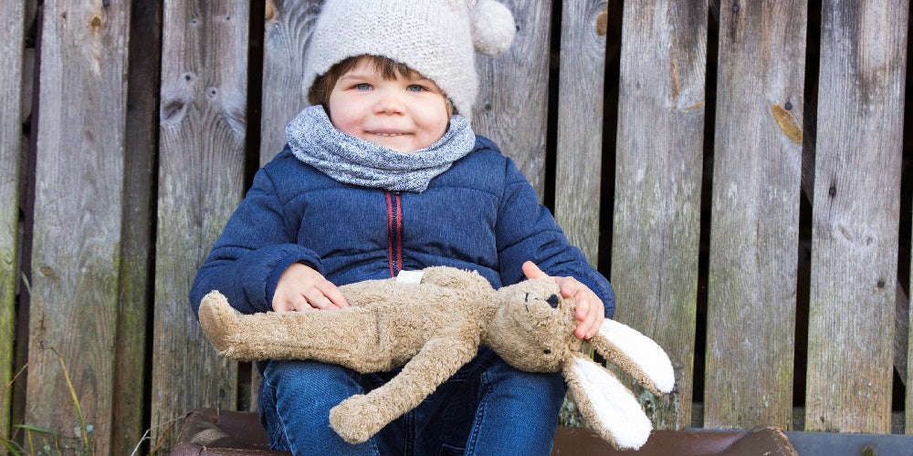 a little boy with his organic soft toy bunny. organic teddy bear and natural baby toys.
