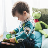 A little boy playing with a green frog cuddly toy. Your perfect organic baby soft toy. All our Efie toys are non-toxic toys and are your perfect organic new baby gift! German eco-friendly toys which are fair trade and natural cuddly toys and organic dolls. Environmentally friendly eco baby toys made to the highest GOTS standards.