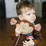 A little boy playing with a monkey cuddly toy. Your perfect organic baby soft toy. All our Efie toys are non-toxic toys and are your perfect organic new baby gift! German eco-friendly toys which are fair trade and natural cuddly toys and organic dolls. Environmentally friendly eco baby toys made to the highest GOTS standards.