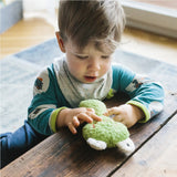 A little boy playing with our green frog rattle. Your perfect organic baby soft toy. All our Efie toys are non-toxic toys and are your perfect organic new baby gift! German eco-friendly toys which are fair trade and natural cuddly toys and organic dolls. Environmentally friendly eco baby toys made to the highest GOTS standards.