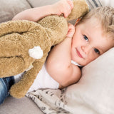 a baby cuddling up to her organic rabbit soft toy. organic toys in the UK from onepurefox.