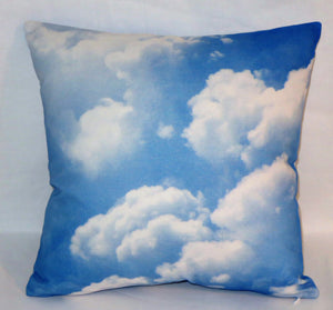Blue sky clouds pillow