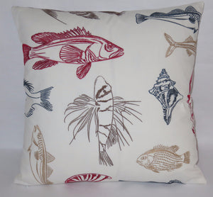 White embroidered sea life pillow