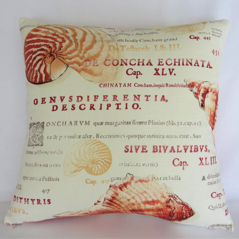 orange seashell and Latin script pillow cover