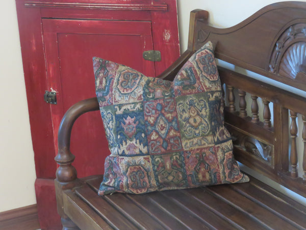 Faded carpet style pillow cover in red, blue green