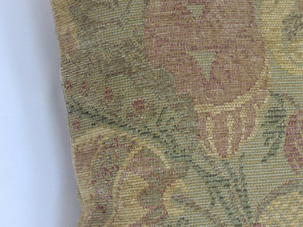 faded green chenille pillow with floral Arts and Crafts motif