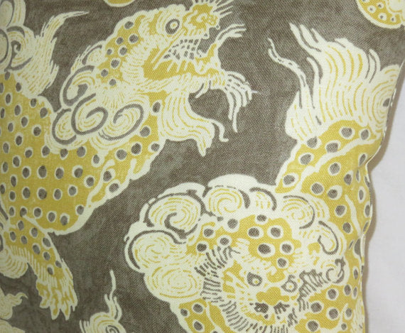 gold and brown oriental dragon pillow
