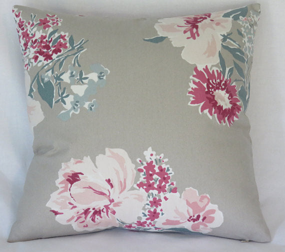 taupe pillow with pink floral pillow
