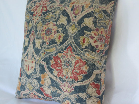 navy blue floral pillow with red orange gold