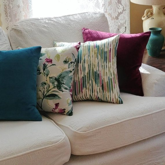 Teal and purple coordinating pillows with kelly ripa print