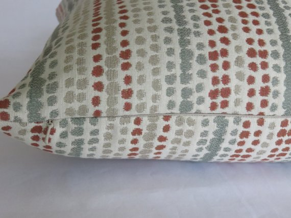 terracotta orange and grey rows of dots pillow