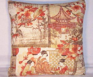 orange brown oriental pillow with geishas
