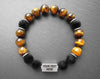 Engraved stainless steel bracelet with brown tiger eye and volcano rock beads