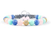 Womens adjustable bracelet with cubic zirconia, aquamarine, rose quartz and mint jade beads