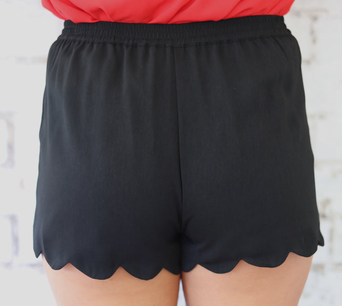 black scallop shorts