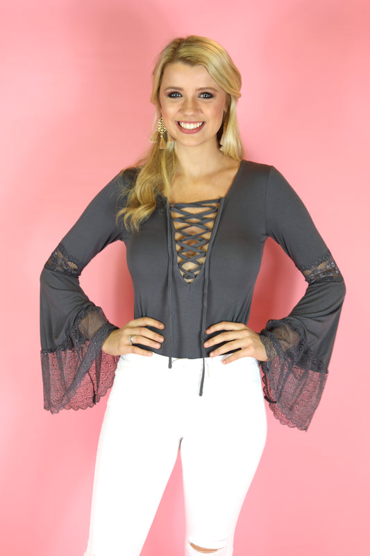 grey lace up bodysuit with lace bell sleeves
