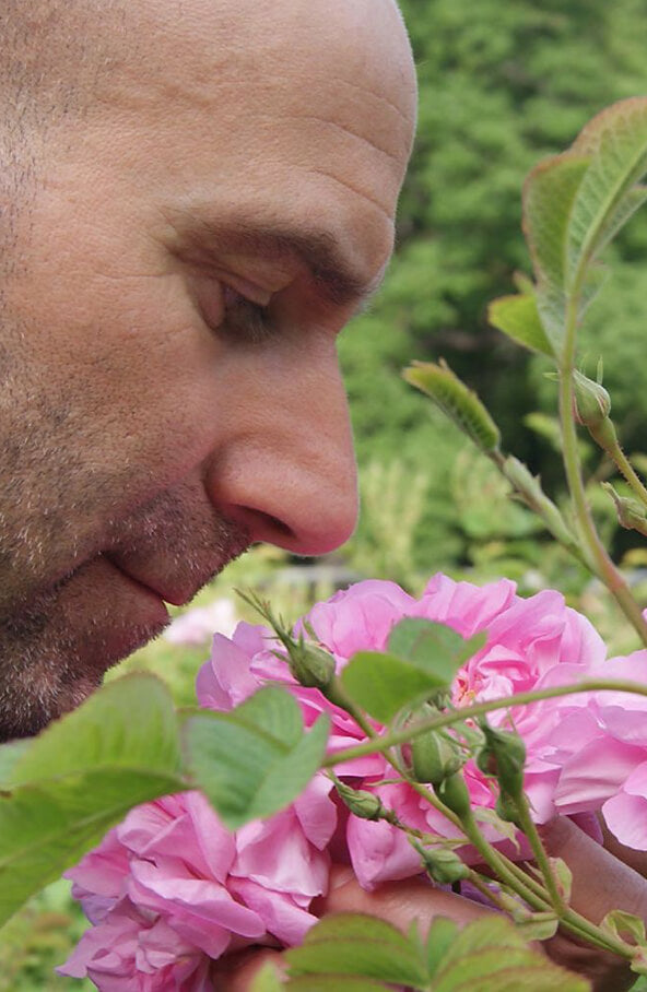 Michel smelling the flowers