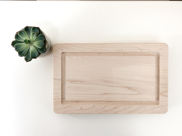 Maple cutting board with engraved family name. Made by Urban Nest Decor