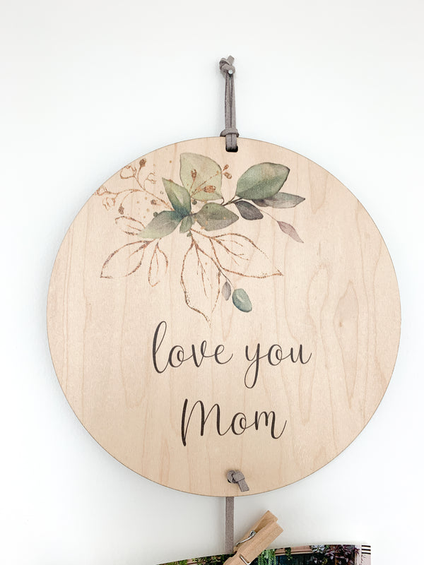 I Love You Mom Memory Keeper with green floral spray. A perfect way to display your favorite photos with this unique wall hanging