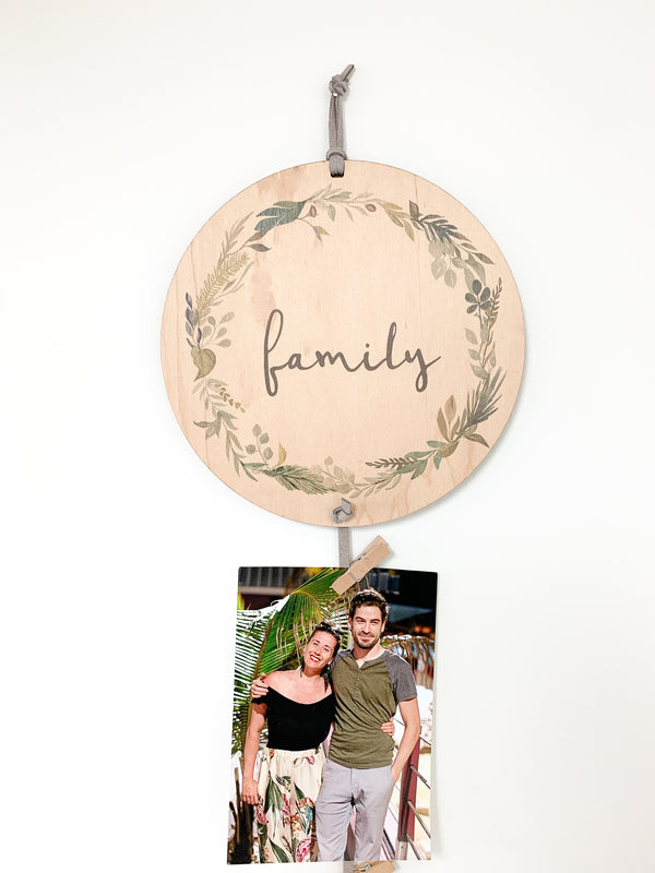Family Memory Keeper with green floral wreath. A perfect way to display your favorite photos with this unique wall hanging