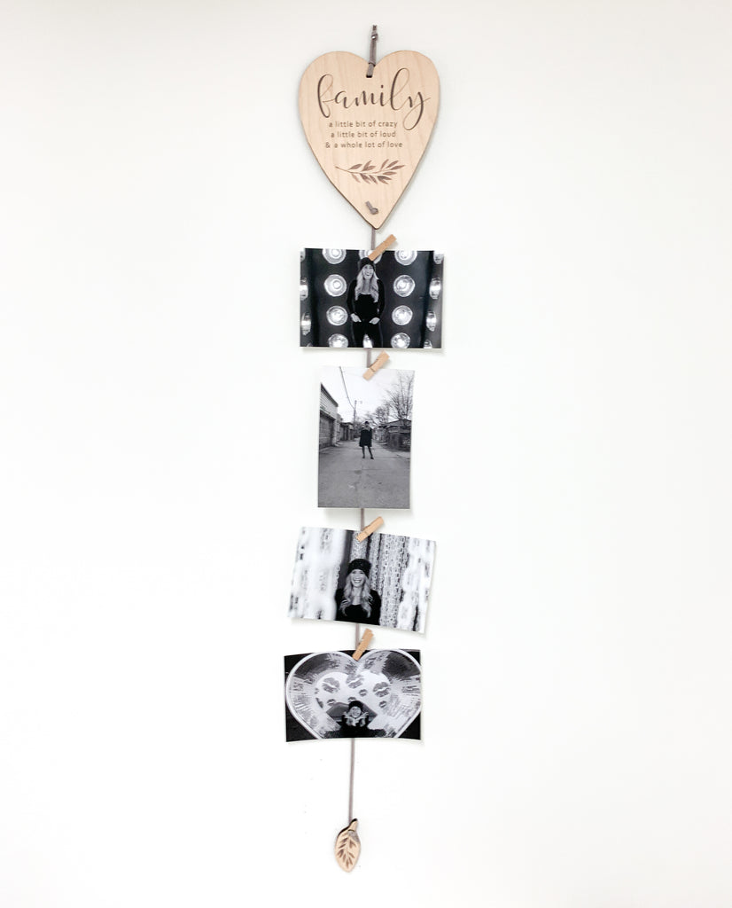 Family is a Little Bit Crazy Heart Memory Keeper. A perfect way to display your favorite photos with this unique wall hanging