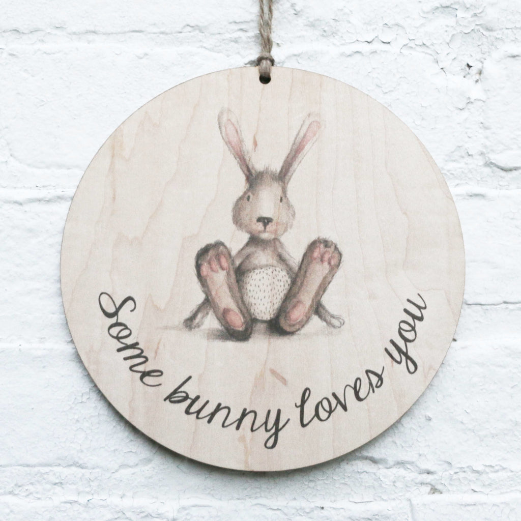 Some Bunny Loves You_Print on Wood hanging on brick wall