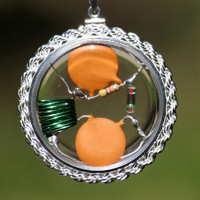 Psychojammer Beta Blocker Crystal Quantum Radio Amulet set in solid .925 sterling silver hand-braided real-rope bezel.