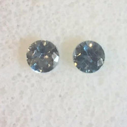 .63 TWCT. MATCHING PAIR, ROUND CUT 4MM MONTANA SAPPHIRES
