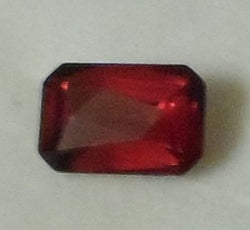 1.80 CTS. BEAUTIFUL EMERALD CUT DARK RED MONTANA GARNET